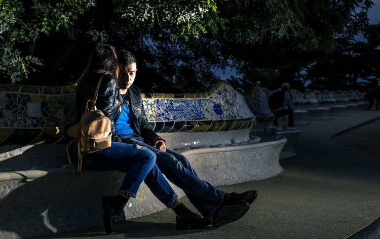Couple in Park Guell at night
